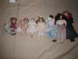 9 Lot Porcelain Dolls Selling as Set Some Clothed Some Wigs