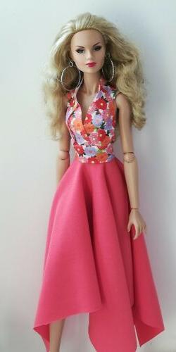 12 inch fashion doll dress is one size fits all same size do